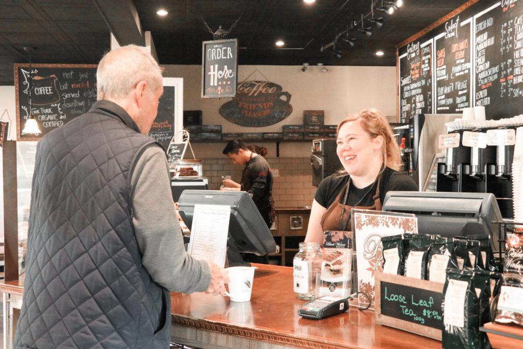Customer Purchasing Coffee at Black Walnut Cafe